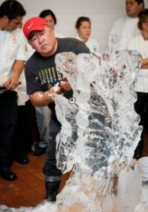 Cook Clifford Goto gives an ice carving demonstration to University of Hawaii Center at West Hawaii culinary students on Wednesday at the Mauna Lani Bay Hotel & Bungalows, using specialized tools to chip away at the ice. (Anna Pacheco/Special to West Hawaii Today)